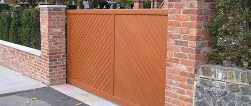 Aluminium gate in golden oak effect installed in Cheshire