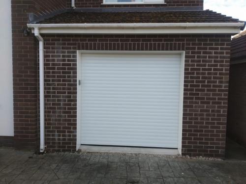 Insulated roller garage door in white