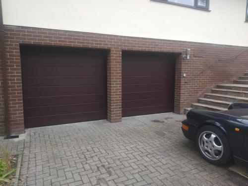 Two insulated sectional garage doors in brown