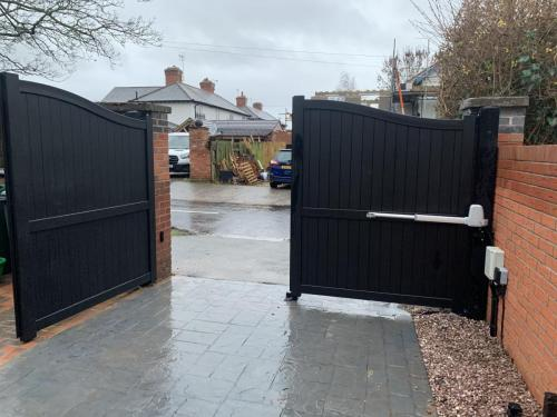 Aluminium gates with a bell curved top