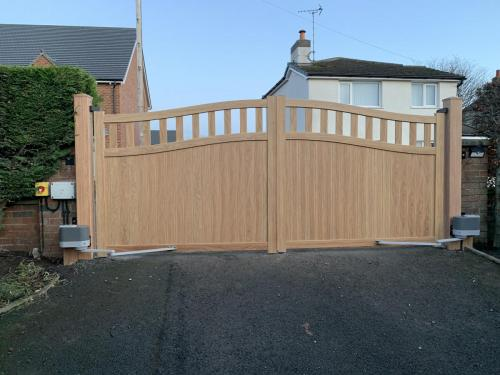 Electric Aluminium gates in Golden Oak internal view