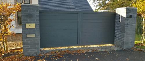Aluminium gate in anthracite with underground installation and access control installed in Cheshire