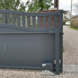Aluminium sliding gate with curved top in anthracite installed in Cheshire