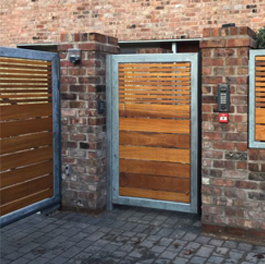 Timber gates with aluminium surround installed at an apartment complex in Cheshire with access control