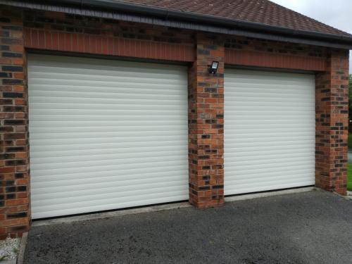 Two Insulated Roller Garage Doors