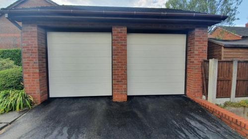 Two sectional garage doors in cream