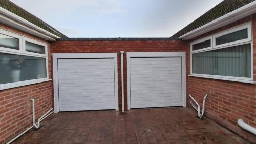 Two Insulated Sectional Garage Doors for neighbours