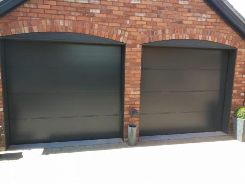 Two Insulated Sectional Garage Doors