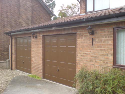 Up and Over garage doors in brown, georgian design installed in Mold