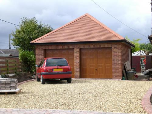 Up and Over garage door in golden oak wood effect, Marquess design installed in Chester