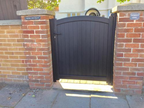 Aluminium matching pedestrian gate in anthracite installed on the Wirral
