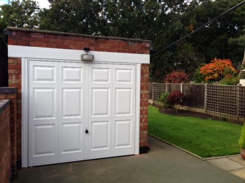 Up and Over garage door in white, georgian design installed in Cheshire