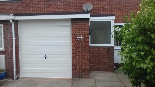 Up and Over garage door in white, horizontal rib installed in Chester