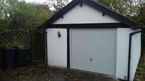 Up and Over garage door in white, ribbed design installed in North Wales