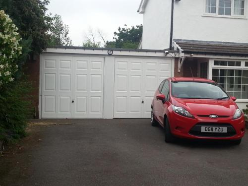 Up and Over garage doors in white, georgian design installed in Chester